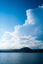 Large billowing clouds above coastal village Royalty Free Stock Photo