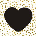 A large black heart on the background of small gold dots