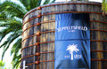 Large blue signage on old wood vats at entrance of Seppeltsfield winery. Royalty Free Stock Photo