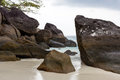 Large boulders on the white sand of the similan islands deserted beach with Royalty Free Stock Images