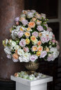 Large bouquet of roses in a vase on a marble pedestal Royalty Free Stock Photo