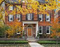Large brick house with fall colors Royalty Free Stock Photo