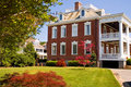 Large brick mansion with porch Stock Photo