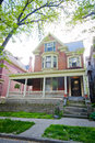 Large brick victorian style home three story made of with yellow trim Stock Photo