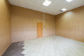 Large bright empty room with one door Stock Photo