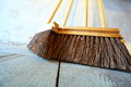 Large brooms on wooden floor housework close up for house work old of country house sweeping Royalty Free Stock Photos