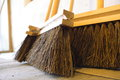 Large brooms on wooden floor housework close up for house work old of country house sweeping Royalty Free Stock Images