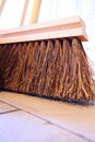 Large brooms on wooden floor housework close up for house work old of country house sweeping Royalty Free Stock Image