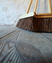 Large brooms on wooden floor housework close up for house work old of country house sweeping Royalty Free Stock Photo