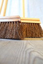 Large brooms on wooden floor housework close up for house work old of country house sweeping Stock Image