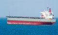 Large bulk carrier ship on calm ocean Royalty Free Stock Photography