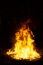 Large ceremonial fire at night flames and smoke fill this image of a during a mayan ritual Royalty Free Stock Photo