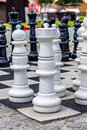 A large chessboard white figures on Stock Images