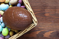 Large chocolate easter egg in a basket Stock Photo