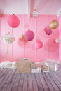 Large Christmas balls on a pink background in children room Royalty Free Stock Photo
