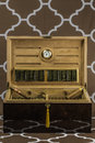 Large cigar humidor a showing off a selection of smokes with the lid open Royalty Free Stock Images