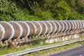 Large concrete drain pipes above ground section of a water liquid Stock Photos