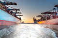 Large container ships in harbor at sunset Royalty Free Stock Photo