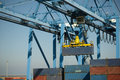 large crane moves  metal container Royalty Free Stock Photo