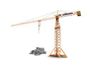 Large crane and pile of bricks Royalty Free Stock Photos
