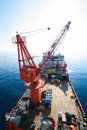 Large crane vessel installing the platform in offshore crane barge doing marine heavy lift installation works gulf or Stock Photos
