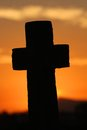 Large cross at sunset Stock Images