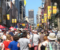 Large crowd on a city street at festival taken august yonge in toronto ontario during the busker's festival Stock Photos