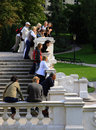 Large crowd tourists making stop their tour city gaze towards green patches city park vienna austria Stock Photo