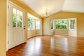 Large empty newly remodeled living room with wood floor. Royalty Free Stock Photo