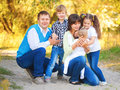 Large family having fun together enjoying and Stock Images