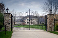 Large fancy mansion behind a gated entry Royalty Free Stock Photo
