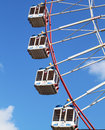 Large ferris wheel s cabins on the blue sky Royalty Free Stock Images