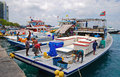 Large fishing vessel docking at male maldives with fishermen working onboard Royalty Free Stock Images