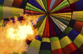 Large flame inside hot air balloon a seen while a is being inflated Royalty Free Stock Images