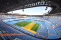 Large football stadium with grandstand and artificial light blue for growing lawns Royalty Free Stock Photo