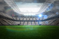 Large football stadium with lights under cloudy sky Royalty Free Stock Photos