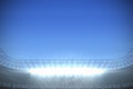 Large football stadium with spotlights under bright blue Royalty Free Stock Photo