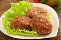 Large fried cutlets with lettuce Stock Photography