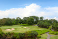 Large golf field for training and blue sky course in luxury resort green on the background of the sea beautiful palm tree over Royalty Free Stock Images