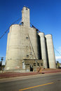 Large grain elevator a busy to load trucks with in eastern washington under clear blue skies Stock Photo
