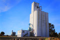 Large grain elevators busy to load trucks with in grass valley in eastern oregon under clear blue skies Stock Images