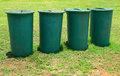 Large green plastic bins Stock Photos