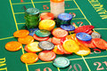 Large group of chips on green baize Stock Photos