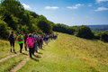 Large group of hikers chiltern hills uk st august a people hiking the chiltern hills during a bright summer day Stock Photo