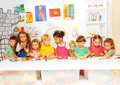 Large group of kids play with plasticine in class Royalty Free Stock Photo