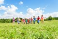 Large group of kids running in the park happy smiling boys and girls on sunny summer day casual clothes Royalty Free Stock Photography