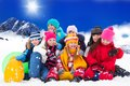 Large group of kids on winter day diversity looking years old boys and girls snow in mountains Royalty Free Stock Photography