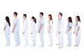 Large group of medical staff standing in a queue diverse white uniforms isolated on white Stock Images