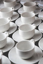 Large group of white coffee tea cups arranged in rows Royalty Free Stock Photo