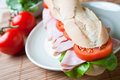 A large ham and tomato baguette Royalty Free Stock Images